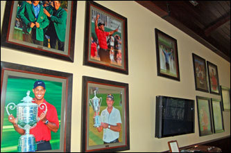 The players' lounge in the clubhouse at TPC Sawgrass includes a wall with photos of the most recent winners of golf's four major championships.