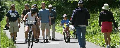 Walkers and cyclists jockeyed for space on the tree-lined Minuteman Bikeway at the Arlington/Lexington line last week.