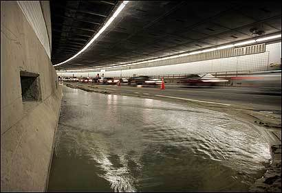 In this photo taken in September 2004, cars passed a flooded area in the Thomas P. O'Neill Jr. Tunnel. The leaks increased the first three months of this year, compared with 2006.