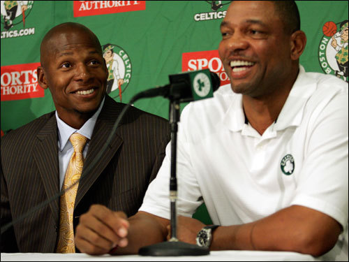Allen laughs as head coach Doc Rivers, left, talks to the media.