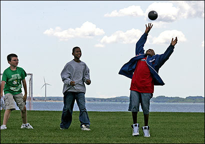 Chris Caras (left), Joshua Hines (center) and Geordel Silva, all 11, played around before a dodgeball game.