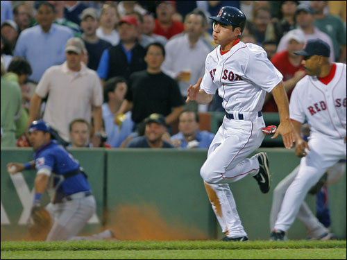 With the aid of third-base coach DeMarlo Hale, right, Ellsbury rumbled around third as Laird chased the ball.