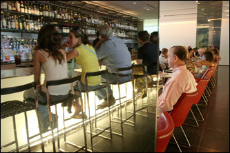 When the Museum of Modern Art moved back into its space on New York City's 53d Street in 2004, the renovated building included three new dining spaces. here, patrons enjoy lunch in the Bar Room at The Modern.