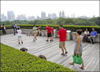 Visitors enjoyed the views of the Manhattan skyline at the Metropolitan Museum of Art's Roof Garden Cafe. The cafe is a delightful refuge with a breathtaking treetop view of Central Park.