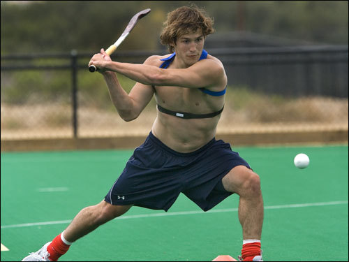 Biceps bulging, bare-chested, and battling for position in front of the net at the US Olympic Training Center, Nate Coolidge looks like the last guy on earth you'd think of to wear a plaid blue skirt. But he did just that nearly a decade ago to play on the girls' field hockey team at Sandwich High School.