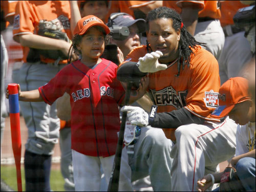 Manny Sr. talks with Manny Jr.
