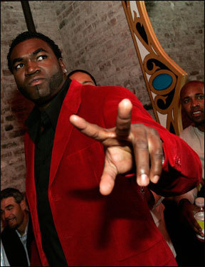 Big Papi flashes a peace sign to the camera as he arrives at the party.