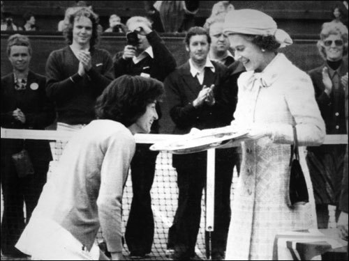 Virigina Wade, the last Brit to win at Wimbledon, is presented the winner's trophy by Queen Elizabeth II. Despite 15 previous failures and an imminent 32d birthday, 'Our Ginny' -- long adored by the British public -- pulled it off by dethroning Chris Evert in the semis and overcoming Betty Stove for the title.