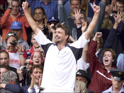 Goran Ivanisevic, a wild-card entry, rose from 125th in the world rankings to No. 1 at Wimbledon, beating Patrick Rafter in five sets before a rowdy crowd in a rain-delayed Monday finale (2001).