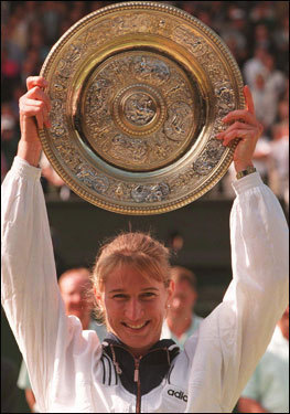 Probably the best-remembered of Steffi Graf's seven titles, though, was a gift from Jana Novotna in 1993. Leading, 6-7, 6-1, 4-1, 40-30, Novotna came apart like a rag doll. She double faulted, won hardly another point, and sobbed on the Duchess of Kent's shoulder at the presentation. At left, Graf hoists her final Wimbledon trophy in 1996.