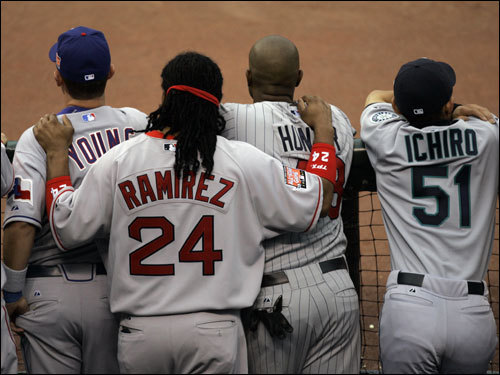 Ramirez looks over the shoulders of Michael Young of the Texas Rangers, and Torii Hunter of the Minnesota Twins, during Tuesday's All-Star game.