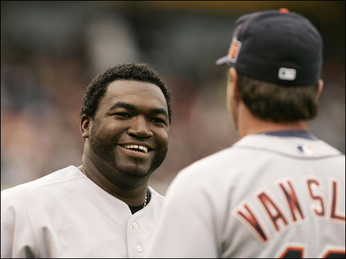 Ortiz talks to first-base coach Andy Van Slyke of the Detroit Tigers after Ortiz hit a fly ball out to end the third inning.