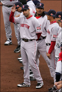 Flanked by his Red Sox teammates, Lowell waves to the crowd during introductions.