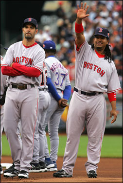 Ramirez, right, waves to the crowd as he and Lowell are introduced before Tuesday's game.