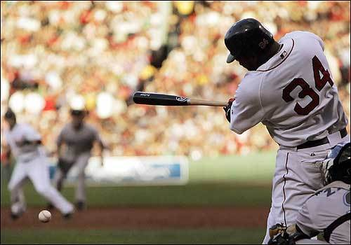 Ortiz belts an RBI single out of the shadows and into the light of the first inning for the Red Sox.