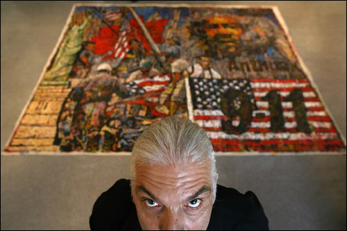 Artist Giovanni DeCunto has opened a studio in the North End. He developed his technique of 'direct painting' about 10 years ago. He paints directly from the tube, without a brush. He stands in front of his 'New Beginning 911.'