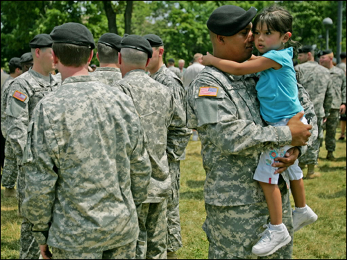 Specialist Roberto Perez of Worcester held his 3-year-old daughter Isabel after a send-off ceremony on the Cambridge Common for his unit, Charlie Company 181st Infantry, of the Massachusetts Army National Guard. The unit is preparing to go to Iraq.