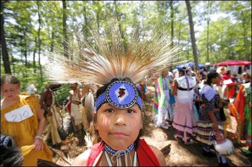 Donovan Collins, 9, a member of the Ho-Chunk Nation in Wisconsin, prepared to dance July 7 in the Grand Procession during the Mashpee Wampanoag Pow Wow.