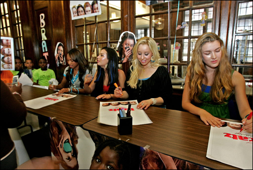 Logan Browning, 18, Jannel Parish, looking up, 18, Skyler Shaye, 20, signing, and Nathalia Ramos, 15, actresses who play the 'Bratz,' signed autographs at the Huntington Ave YMCA July 10.