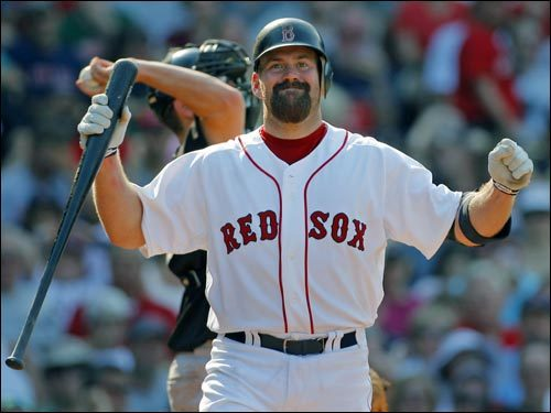 Kevin Youkilis shows his frustration after chasing a bad pitch and striking out in the eighth inning with Manny Ramirez on first base and one out.