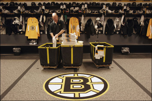 Keith Robinson is no stranger to getting up close and personal with the Bruins players. Here, Robinson attends to one of his many chores — folding the Bruins socks in their TD Banknorth Garden locker room. Robinson, a two-decade assistant Bruins equipment manager, makes sure the sticks are taped, the skates repaired, the jerseys washed, and the locker room stocked with everything from practice pucks to chewing gum for the players.