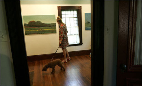 Simon checks out new paintings by Allen Whiting at his studio in West Tisbury. ''I only collect work by artists that I know,'' Simon says.