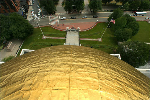 The view from the top of the Boston skyline's brightest sight is equal parts inspirational and dizzying as it looks over Beacon Street. In 1802, Paul Revere & Sons put a copper shield on the dome to stop water leaks. About 70 years later, the dome was gilded with 23 carat gold leaf. The dome was most recently regilded in 1997 for $300,000 — more than 100 times more costly than the original gilding. During that process, six pounds of gold leaf were delivered in a shoebox to the State House. The leaf is as thin as the cellophane that wraps around a box of cigarettes, Kraus said.