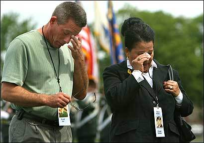 Gordy Dibler and Maria Duran wipe tears during a ceremony and care package send-off at Lawrence's Veterans Memorial Stadium. Dibler's stepson Byron Fouty disappeared along with Duran's son, Alex Jimenez while on patrol in Iraq on May 12.