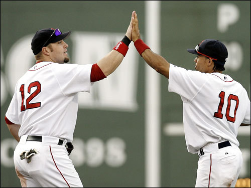 Just when the slump talk was really picking up steam, Eric Hinske (left), Coco Crisp, and the rest of the Red Sox kicked it into high gear over the weekend. The Red Sox took all three weekend games against Chicago, outscoring the White Sox 29-10. Here's a look at what went right...