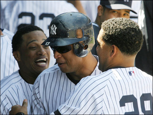 And lest we forget the Yankees, who actually gained half a game (they played a doubleheader Saturday) over the Red Sox this weekend. New York scored 38 runs in two days, capped by a 21-4 drubbing of the Devil Rays Sunday. It doesn't look like they're going away.