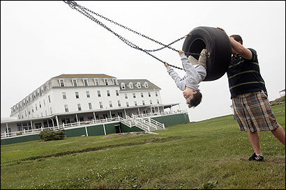 Kyle Belmont, the Star Island, N.H., youth coordinator, gave a push to 3-year-old Griffen Laverty in front of the landmark Oceanic Hotel.