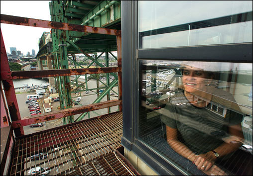 With a rarely seen view of the Tobin Bridge from Massport's offices underneath the toll booths, bridge administration manager Kathy Glowik said there are some continuous reminders of the office's location. 'In my office the bobblehead Ray Bourque figure is always bobbling,' she said. Trucks passing above cause vibrations in the offices, which she said sometimes make visitors uneasy. About 76,000 vehicles travel over the bridge each day.