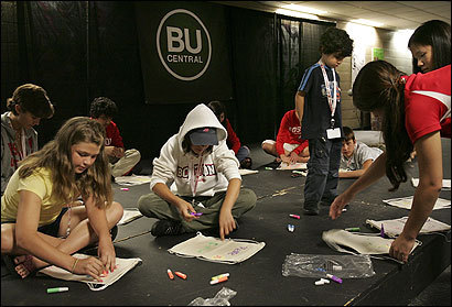 Children at Boston University's sibling program worked on a craft activity while their incoming freshman siblings attended orientation last week. More colleges are opening such programs.
