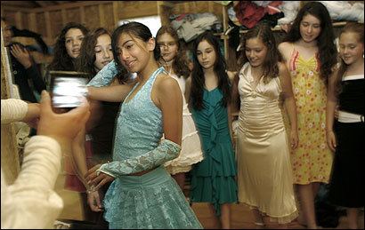 Sabrina Eliaev's American bunkmates watched in Sunapee as she modeled the dress she plans to wear at a formal dance.