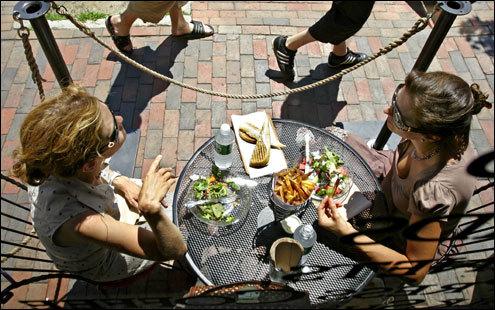 Celine Kuhn & Beth Kubik have salads & Belgian fries during lunch at Duck Fat in Portland, ME.