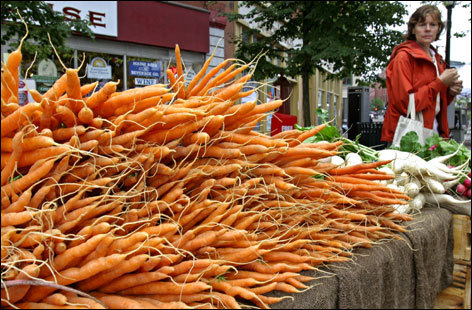 Carrots are among the offerings at the farmers' market in Portland.