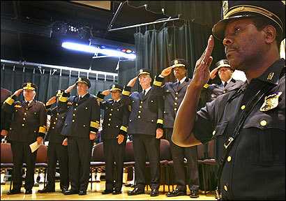 The new command staff joined in saluting the national anthem during the Mattapan ceremony.