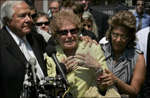 An emotional Marie Salvati talked to the media about her husband's 30-year jail term, while Joe and daughter Maria Sidman stood by her outside the courthouse. The award included compensation for the years each of the men spent in prison, as well as money to the men's wives and children, who had taken the stand during the trial and emotionally recounted how their lives had been shattered.