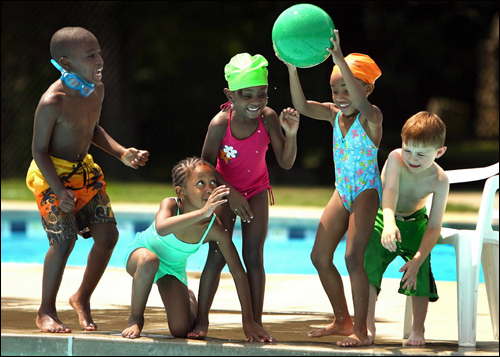 Children in the Project JumpStart summer program for Metco students from Boston, chased a loose beach ball at the Codman Pool during the free swim program they have four times a week at the facility. A recent Supreme Court ruling is raising questions on whether the program's mission will change in the future and admit white children.