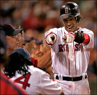 Julio Lugo pointed to Manny Ramirez July 20 as he approached the dugout after hitting a grand slam against the Chicago White Sox in the eighth inning. The Red Sox won the game 10-3.