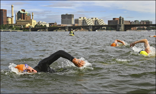 Participants neared the finish line during the first Charles River swim in Boston Saturday. One hundred people took part in the mile-long swim between the Harvard and Longfellow bridges.