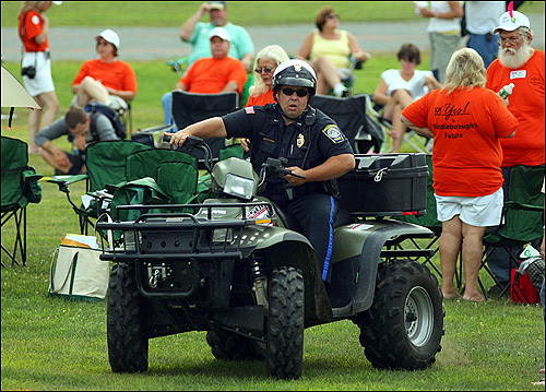 At the Middleborough town meeting, security was tight, as a Middleborough Police officer patrolled in an ATV.