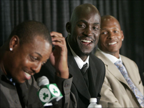 Pierce, left, chuckles as he addresses the media, while Garnett, center, and Allen look on.