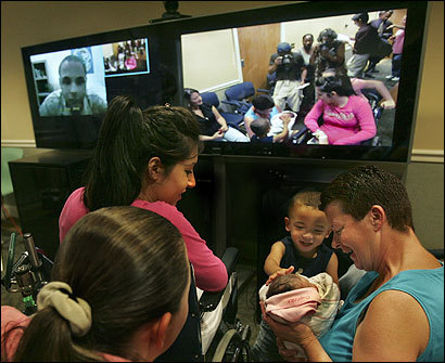 Lance Corporal Tyrelle Greene (far left), who is currently stationed in Iraq, saw the birth of his first child via video.