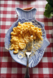Macaroni and cheese sits on a fish-shaped plate at child-friendly Louie Linguine's.