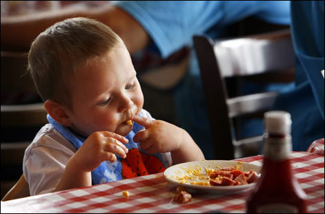 Conner Grenfell, 15 months, eats macaroni and cheese with a hot dog at Louie Linguine's in Monterey. He and his family were visiting from Rocklin, Calif.