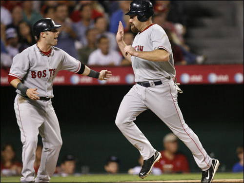 Ramirez's double plated Dustin Pedroia (left) and Kevin Youkilis with the Sox' first runs of the game.