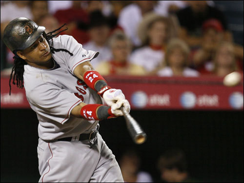 Manny Ramirez sparked the four-run uprising in the fourth by launching a two-run double.