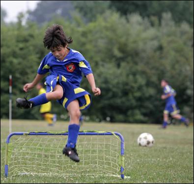 Paulo Dasilva, 7, went through soccer drills Monday at practice in Framingham.