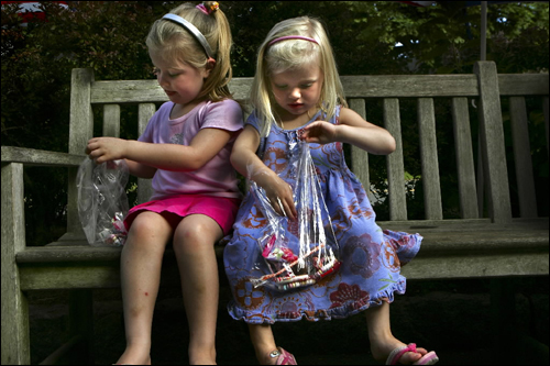 Madelyn Carroll, 4, and her sister Grace, 3, enjoyed their penny candy outside the Brewster General Store.